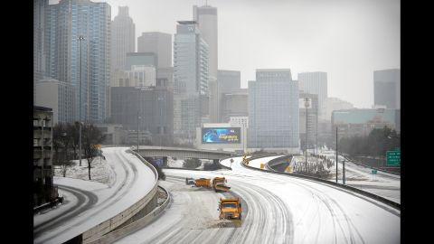 Snowplows clear Interstate 75/85 in downtown Atlanta on February 12.