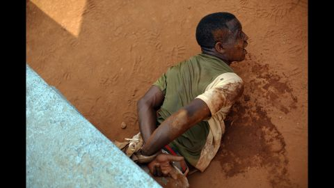 A man screams after being arrested in downtown Bangui on Saturday, February 1.