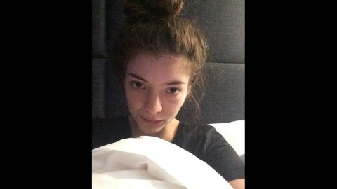 """Singer Lorde posted a makeup-less selfie on her Instagram account in February 2014 with the caption """"In bed in Paris with my acne cream on."""""""