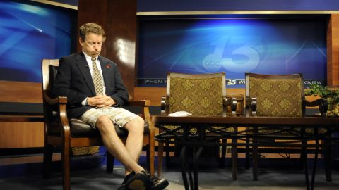 Coming from his son's soccer game, Paul wears shorts and a suit jacket while preparing for his guest spot on a Fox News television program in May 2010.