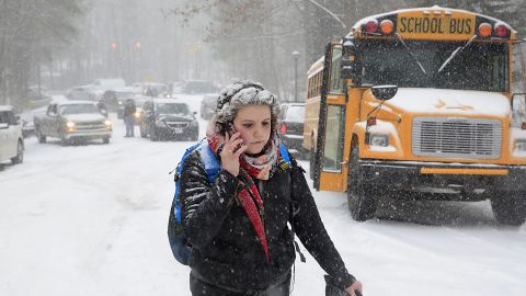 Katharine Newton, a student at the University of North Carolina at Chapel Hill, calls her parents February 12 while walking more than two miles from campus to her parents' home.