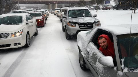 Kevin Miller looks out the passenger window of his friend's car as they sit stuck in traffic during a winter storm in Raleigh on Wednesday, February 12.