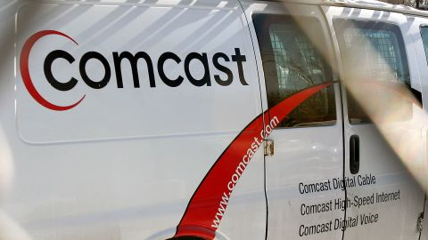 MOUNT PROSPECT, IL - DECEMBER 05: Comcast service truck outside of a Comcast Payment and Technical Facility December 5, 2005 in Mount Prospect, Illinois. Comcast, along with other cable companies nationwide, are planning on raising their rates as soon as the first of the year. (Photo by Tim Boyle/Getty Images)