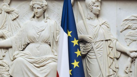 The French flag is set in front of a bas-relief at the French national assembly taken on November 24, 2010 in Paris.