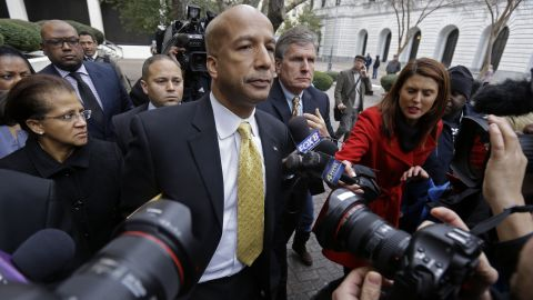 Former New Orleans Mayor Ray Nagin leaves federal court with his wife Seletha, left, after his conviction in New Orleans, Wednesday, Feb. 12, 2014. Nagin was convicted Wednesday on charges that he accepted bribes, free trips and other gratuities from contractors in exchange for helping them secure millions of dollars in city work while he was in office, including right after Hurricane Katrina. The federal jury found Nagin guilty of 20 of 21 counts against him. (AP Photo/Gerald Herbert)