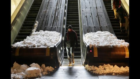 Snow collects at the base of escalators at the Dupont Circle Metro Station in Washington on February 13.