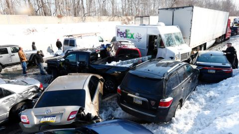 Vehicles are piled up in an accident, Friday, Feb. 14, 2014, in Bensalem, Pa. Traffic accidents involving multiple tractor trailers and dozens of cars have completely blocked one side of the Pennsylvania Turnpike outside Philadelphia and caused some injuries. (AP Photo/Matt Rourke)
