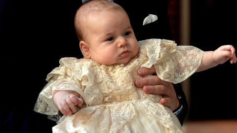 """<a href=""""http://www.cnn.com/2014/12/13/world/gallery/prince-george/index.html"""" target=""""_blank"""">Prince George</a> of Cambridge arrives with parents Prince William, Duke of Cambridge, and Catherine, Duchess of Cambridge, for his christening on October 23, 2013."""