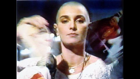 Sinead O'Connor tears up a photo of Pope John Paul II Oct. 5,1992 during a live appearance in New York on NBC's Saturday Night Live.