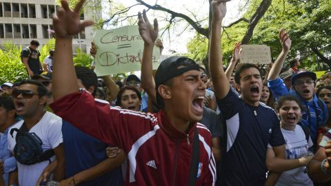Students take part in an anti-government protest in Caracas on February 17, 2014.