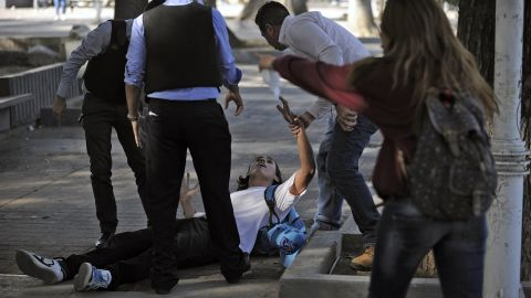 Police detain a student during clashes in Caracas on February 12.