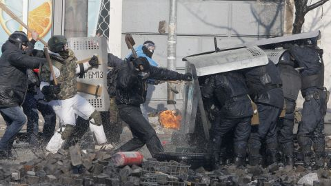 Protesters clash with riot police outside Ukraine's parliament in Kiev on February 18.
