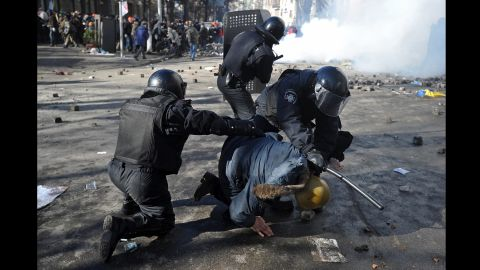 Riot police detain a protester in Kiev on February 18.
