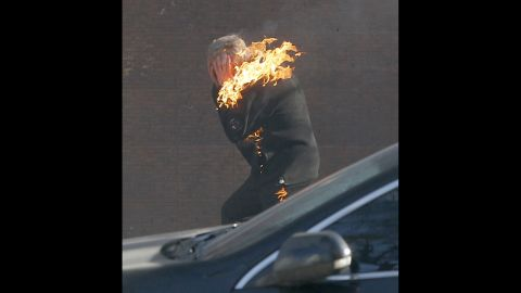 A protester is engulfed in flames while running from the clashes in Kiev on February 18.
