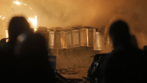 Riot police storm Independence Square on February 18.