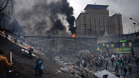 Protesters move up an embankment in Kiev on February 20.