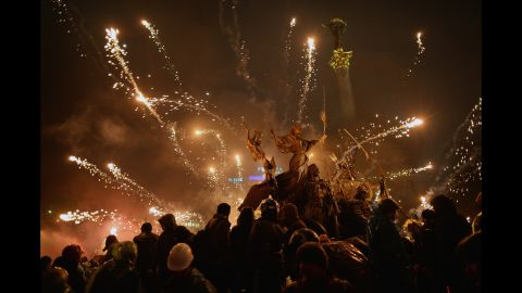 Fireworks explode over protesters in Independence Square on Wednesday, February 19.