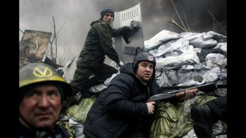 Protesters man a barricade on the outskirts of Independence Square on February 20.