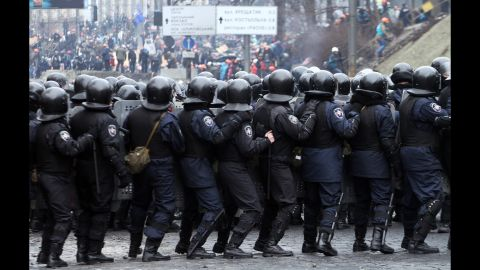 Riot police face protesters in Kiev on February 20.
