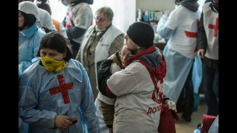 Medics embrace in the lobby of the Hotel Ukraine on February 20.