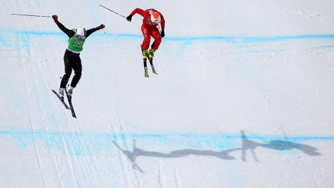 Jouni Pellinen of Finland, left, leads Armin Niederer of Switzerland during the men's ski cross.