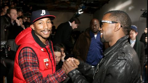 In 2010, Pharrell tried to trick us into thinking he was aging with a mustache and a fake gold tooth, but we can see under the mask, P.