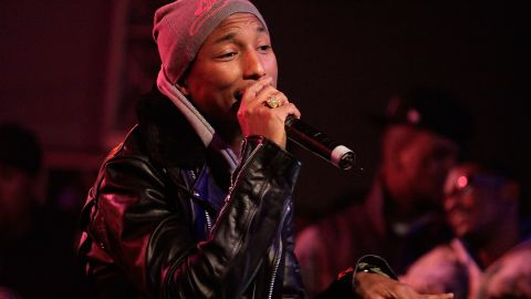 """If we didn't know better, we'd think Pharrell was stuck in some sort of """"Benjamin Button""""-like aging process, wherein he was born looking 22 and then never ages at all."""