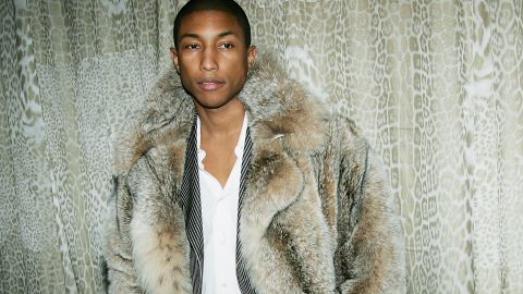 By 2004, Pharrell had been outed as the music industry's go-to guy for a chart-topping hit. But even with the increased visibility and work, do you see a stress wrinkle on this guy's face? Because we don't.