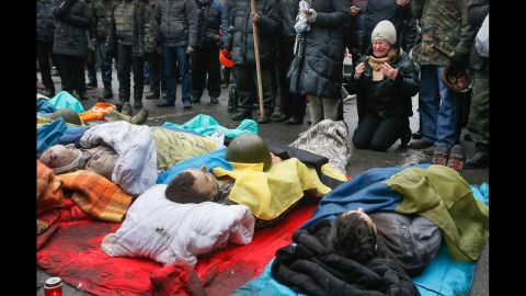 A woman on February 20 mourns over protesters who were killed during clashes.