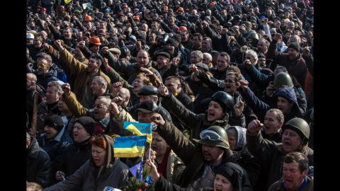"""Ukrainian demonstrators gather in Kiev's Maidan, or Independence Square, on February 21, 2014, a day after the bloodiest day of revolution protests. <a href=""""http://www.cnn.com/2015/02/20/europe/ukraine-conflict/index.html"""">Nearly 50 activists were killed and hundreds more injured in clashes </a>in the square on February 20, 2014. The street protests soon led to the ouster of pro-Russian President Viktor Yanukovych and triggered a chain of events that included Russia's annexation of Ukraine's Crimean Peninsula and fighting in Eastern Ukraine with pro-Russian separatist forces."""