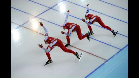 From left, Polish speedskaters Natalia Czerwonka, Katarzyna Bachleda-Curus and Luiza Zlotkowska compete in the women's team pursuit quarterfinals on February 21.