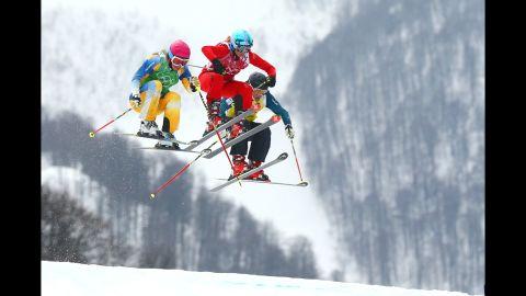 From left, Sandra Naeslund of Sweden, Jorinde Mueller of Switzerland and Jenny Owens of Australia compete in the women's ski cross on February 21.