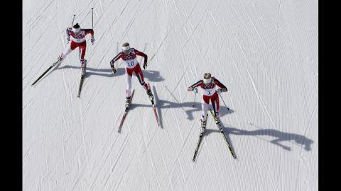 From left, gold medal winner Marit Bjoergen, bronze medal winner Kristin Stoermer Steira and silver medal winner Therese Johaug, all from Norway, ski during the  30-kilometer cross-country race on February 22.