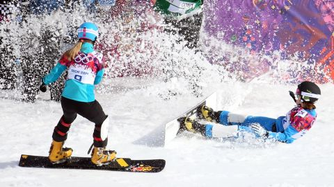 Julia Dujmovits, right, of Austria celebrates her gold medal in ladies' snowboard parallel slalom on February. She defeated Anke Karstens of Germany, left.