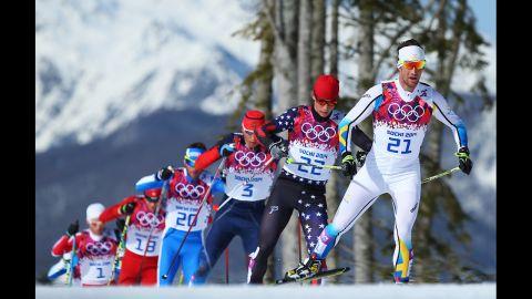 Anders Soedergren of Sweden leads the pack in the men's 50-kilometer mass start free on February 23.