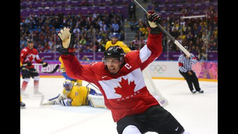 """Sidney Crosby celebrates after scoring Canada's second goal during the men's ice hockey gold medal match against Sweden on Sunday, February 23. Most of us know the Winter Olympics through the power of television, as a spectacle in constant motion. Seeing the Games through still photography is a different experience altogether. Here's a look at the most compelling images from the word's best photographers at Sochi 2014.   <em>More photos:</em> <a href=""""http://www.cnn.com/2014/02/08/worldsport/gallery/falling-down-in-sochi/index.html""""><em>Falling down in Sochi </em></a>"""