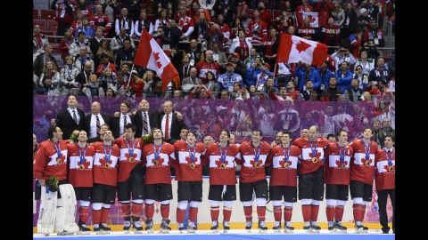 Canada's hockey team receives their gold medals in front of an ecstatic crowd on February 23.