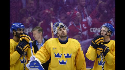 Henrik Lundqvist, center, and his teammates on the Swedish hockey team received silver medals on February 23.