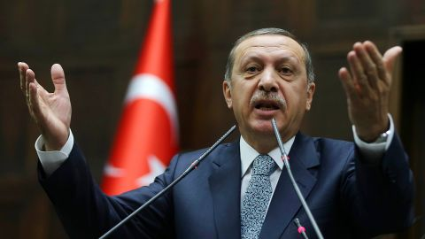 Turkey's Prime Minister Recep Tayyip Erdogan addresses members of his ruling AK Party (AKP) during a session at the Turkish parliament in Ankara on February 25, 2014.