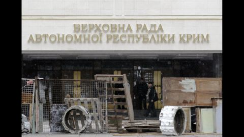 Protesters stand in front of a government building in Simferopol on February 27. Tensions have simmered in the Crimea region since the ouster of Ukrainian President Viktor Yanukovych.