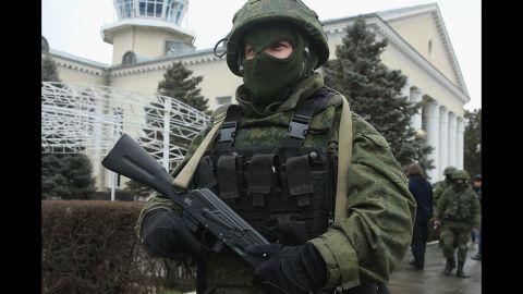 An armed man wearing no identifying insignia patrols outside Simferopol International Airport on February 28.