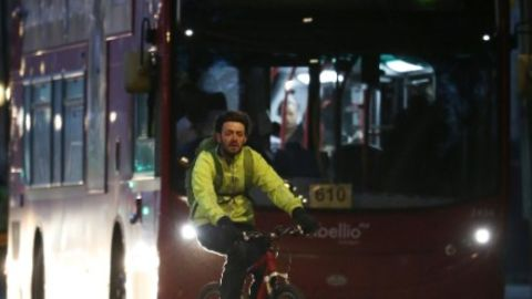 Cycling in the shadow of a London bus.