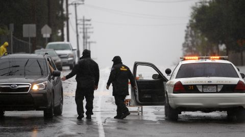 GLENDORA, CA - FEBRUARY 28:  A roadblock keeps people from entering an evacuated neighborhood below the Colby Fire burn area as a storm brings rain in the midst of record drought on February 28, 2014 in Glendora, California. The rain offers some relief to the dry conditions but is not expected to be enough to break the historic drought. A drought-related unseasonal wildfire, the Colby Fire, was accidentally ignited in the dry chaparral vegetation in January, destroying homes and sending thousands fleeing. The charred and denuded hillsides are threatening the homes of about a thousand evacuated residents with rain-loosened mud-ash debris flows.   (Photo by David McNew/Getty Images)