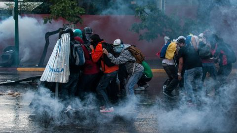Protesters clash with police forces in Caracas on March 1.