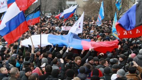 Pro-Russian activists hold Russian flags during a rally in the center of Donetsk on March 1.