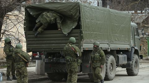 Heavily armed soldiers displaying no identifying insignia maintain watch in Simferopol on March 1.