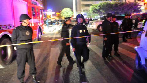 Police gather near the scene of the attack.