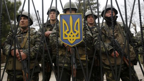 Ukrainian soldiers guard a gate of an infantry base in Perevalne on March 2.