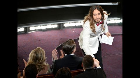 """Jared Leto shakes hands with an audience member after winning the best supporting actor Oscar for his role in """"Dallas Buyers Club."""""""
