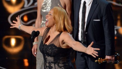"""Darlene Love sings while accepting the award for best documentary feature (""""20 Feet from Stardom"""")."""